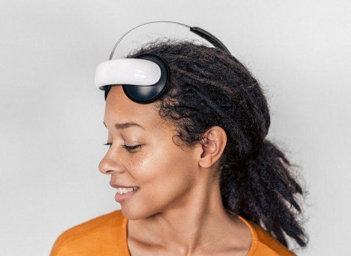 A woman wearing the Flow Neuroscience headset.