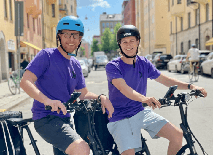 Kavall co-founders Robin Rendahl and Peter Simon pose on two of the company's delivery bikes.