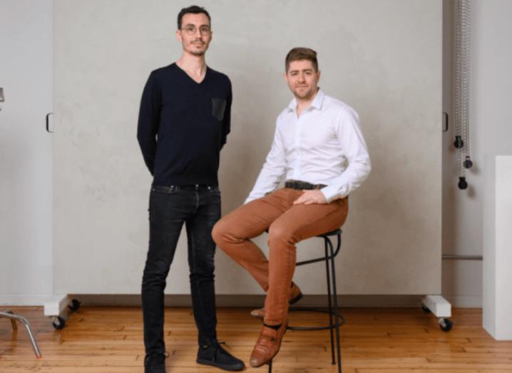 Ramp co-founders Karim Atiyeh and Eric Glyman sit in a studio.
