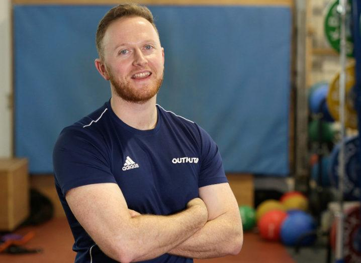 Photo of CEO Dr Martin O'Reilly standing in a gym with his arms folded.