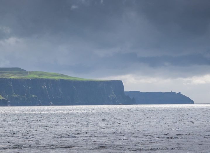 The Cliffs of Moher are pictured with storm clouds coming in from the ocean.