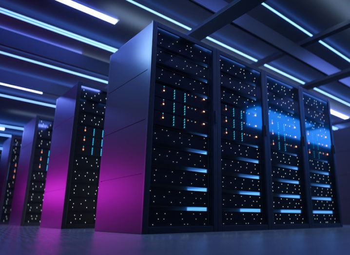 Image of a data centre under purple and blue lights.