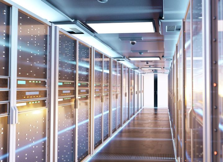 Image of a data centre, with servers lining a corridor.