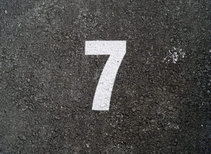 The number seven printed on a road.