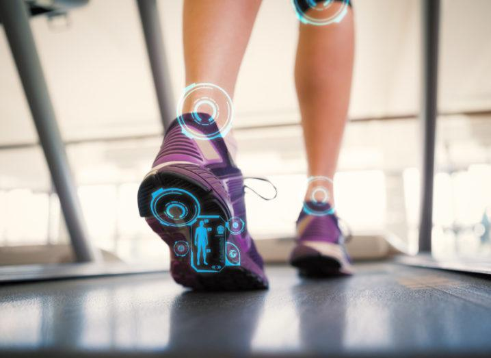 Image of a person's shoes while they're running on a treadmill.