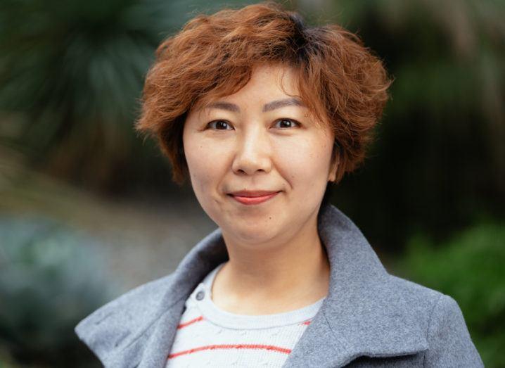 Photo of Wei Gao smiling.