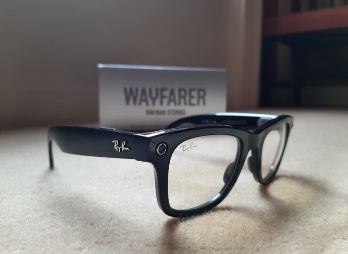 A close up of the Ray-Ban stories, in the Wayfarer style with black frames and clear lenses.