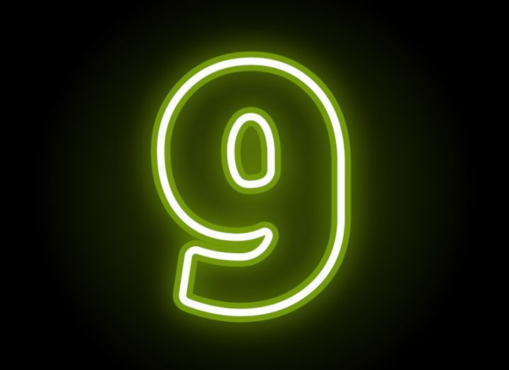 Neon green image of the number nine against a black background.