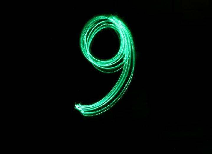 The green flourish of a long exposure light in the shape of the number nine.