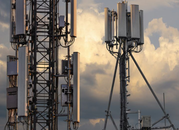 Base stations and mobile phone transmitters against a cloudy evening sky