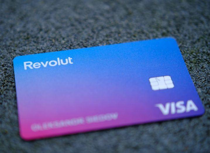 A blue and purple Revolut Visa debit card.