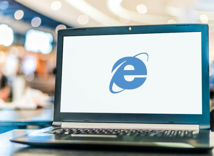 The Internet Explorer logo on a laptop screen.