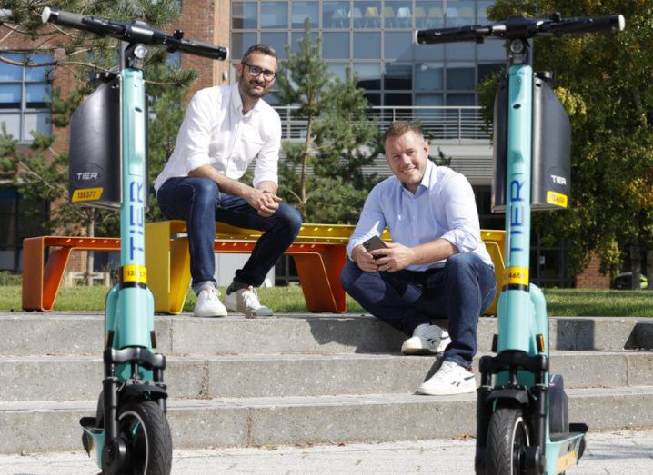 Fred Jones, Northern Europe general manager of Tier and Niall Carson, general manager of Free Now Ireland, at Dublin City University (DCU) campus with two e-scooters.