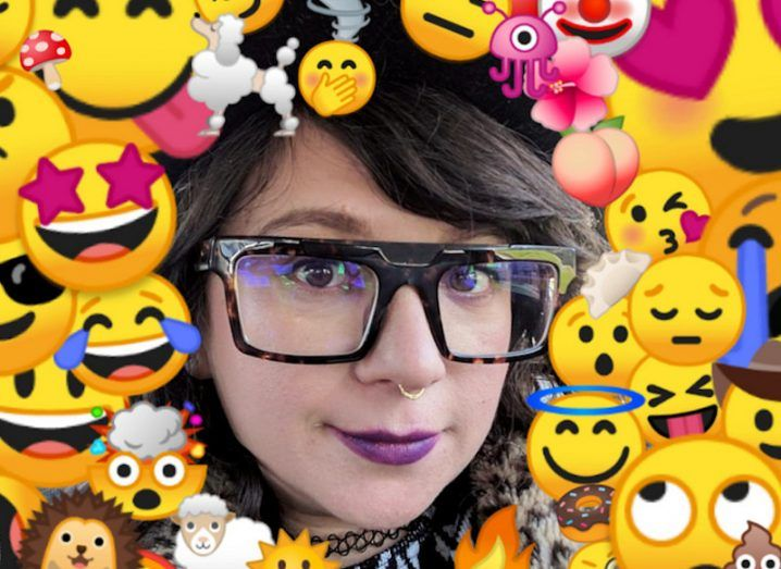A woman's face is surrounded by different emoji graphics.