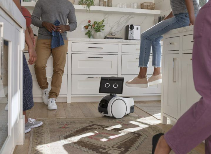 A promotional image of the Amazon Astro robot on a kitchen floor.