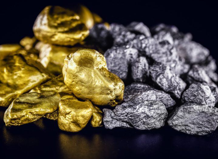 Nuggets of silver and gold are piled on top of a black surface. The nuggets are shining and look valuable but their use could also offer a new way of storing hydrogen energy.