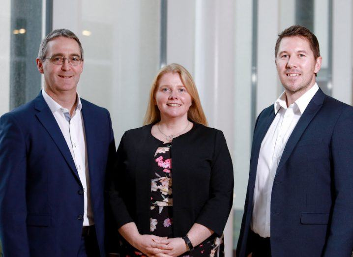 The founding members of Nua Surgical are pictured. Padraig Maher, Marie-Therese Maher and Barry McCann are standing beside each other and smiling at the camera.