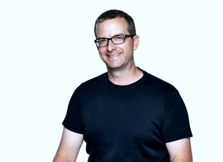 A headshot of outing CTO Mike Schroepfer in a black T-shirt against a white background.