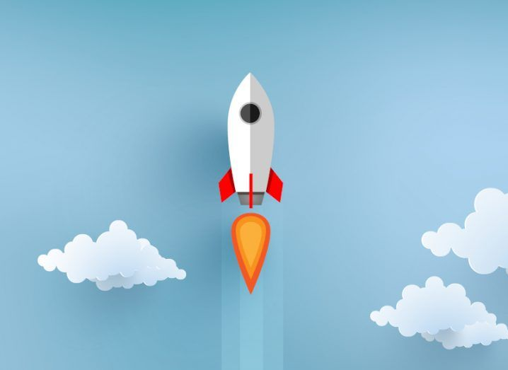 An illustration of a rocket flying upwards against a blue sky surrounded by clouds, representing skyrocketing tech deals in Europe.