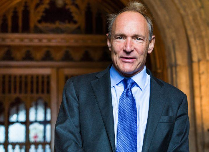 Tim Berners-Lee smiling in a suit at London's Guildhall.