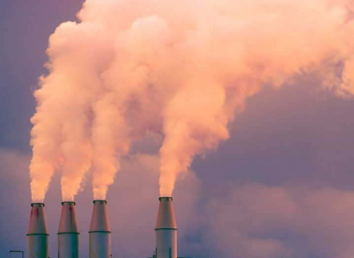 Smoke billowing from the chimneys of an energy station, polluting the sky.