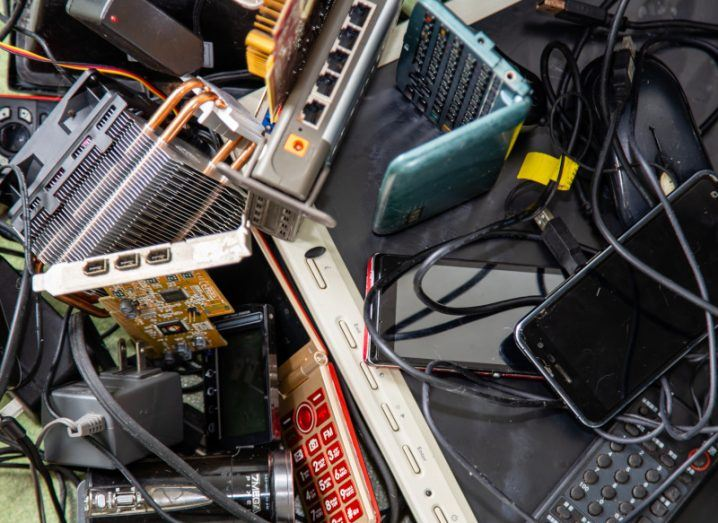A messy pile of discarded electronic/ e-waste products.