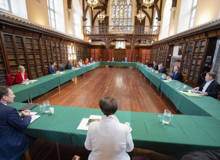 The cabinet sit around a large table in a room at UCC.