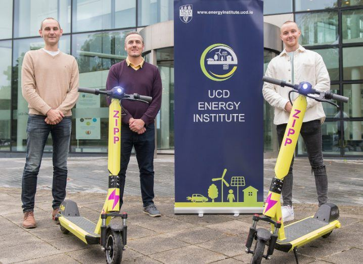 Prof Andrew Keane, Dr Paul Cuffe and Charlie Gleeson standing outside UCD at the launch of their research project, with two Zipp e-scooters in front of them.