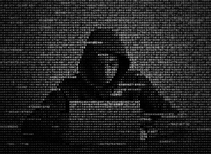 Illustration of hoodie-wearing hacker using a laptop.