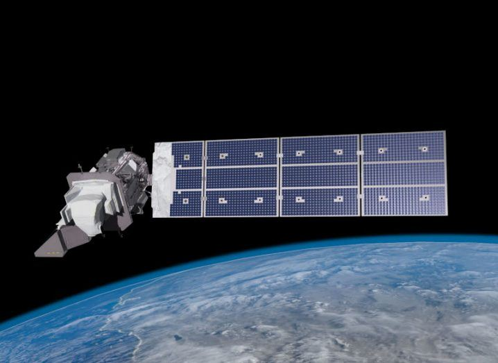 Artist's conception of the Landsat 9 satellite in orbit. Earth in the background.