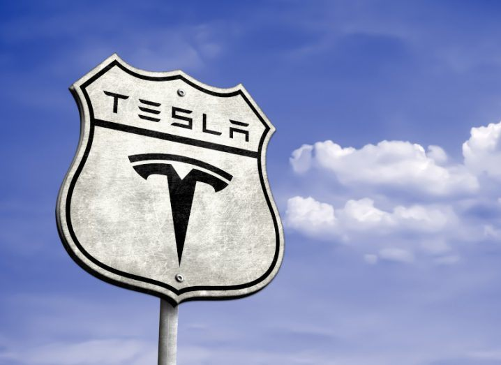 A Tesla logo on a highway sign in Austin, Texas.